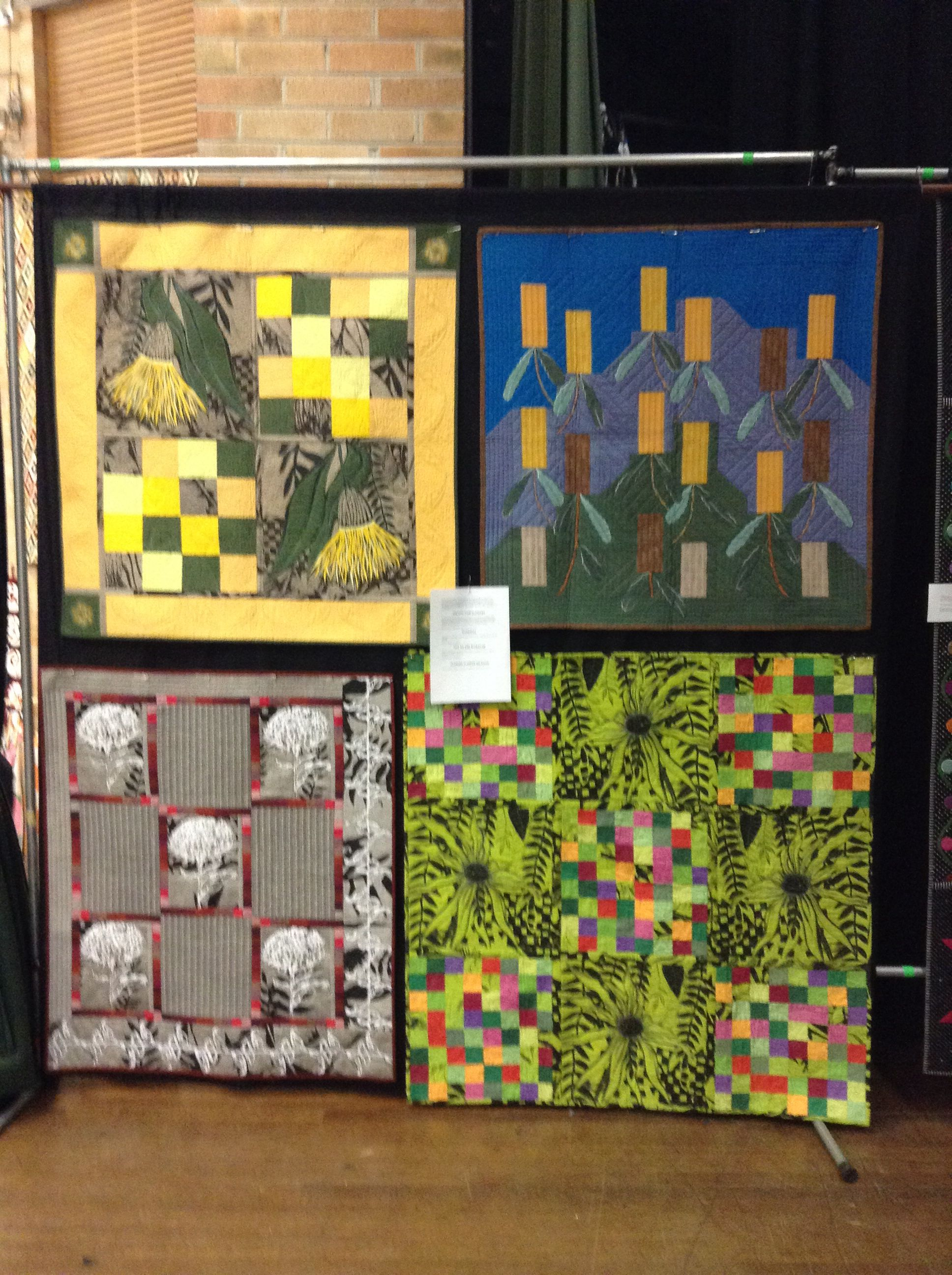 Four botanical themed quilts made from Reece Scanell's