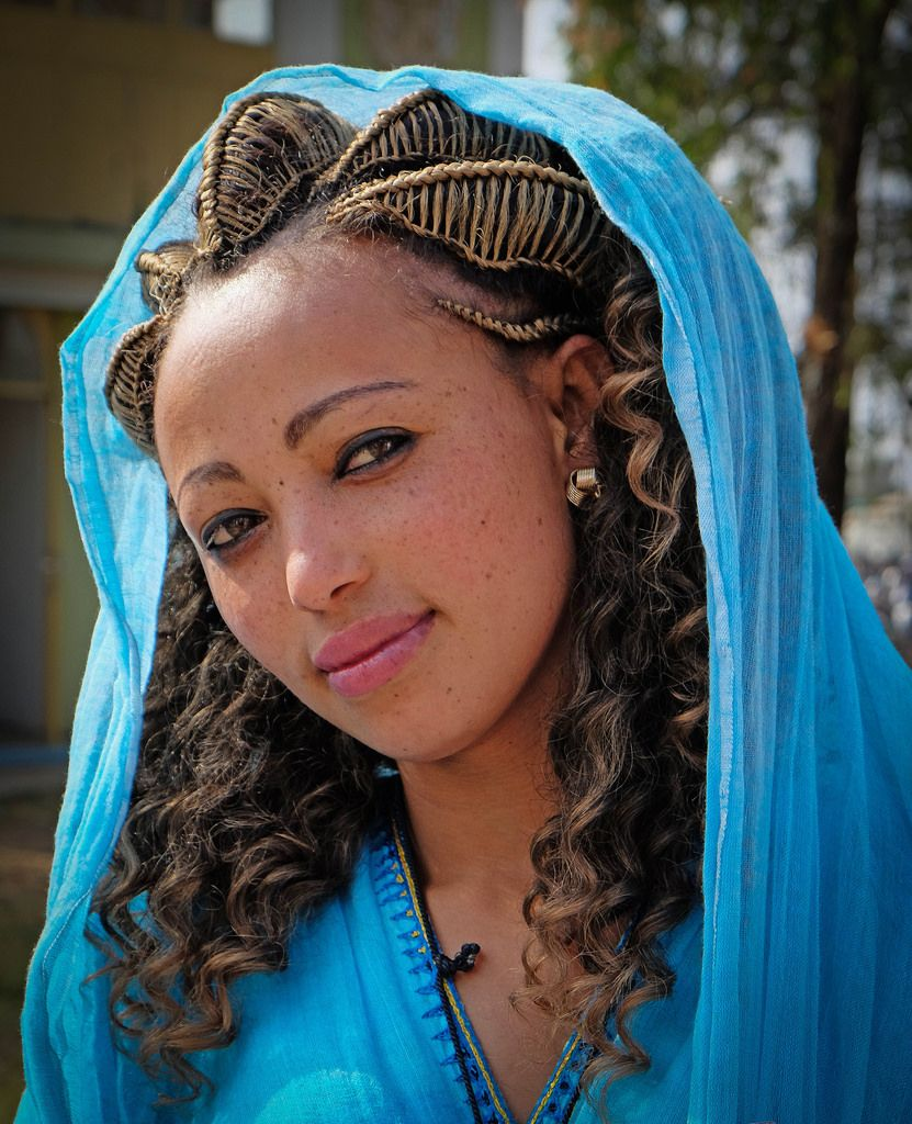 Young Ethiopian woman wearing traditional dress and