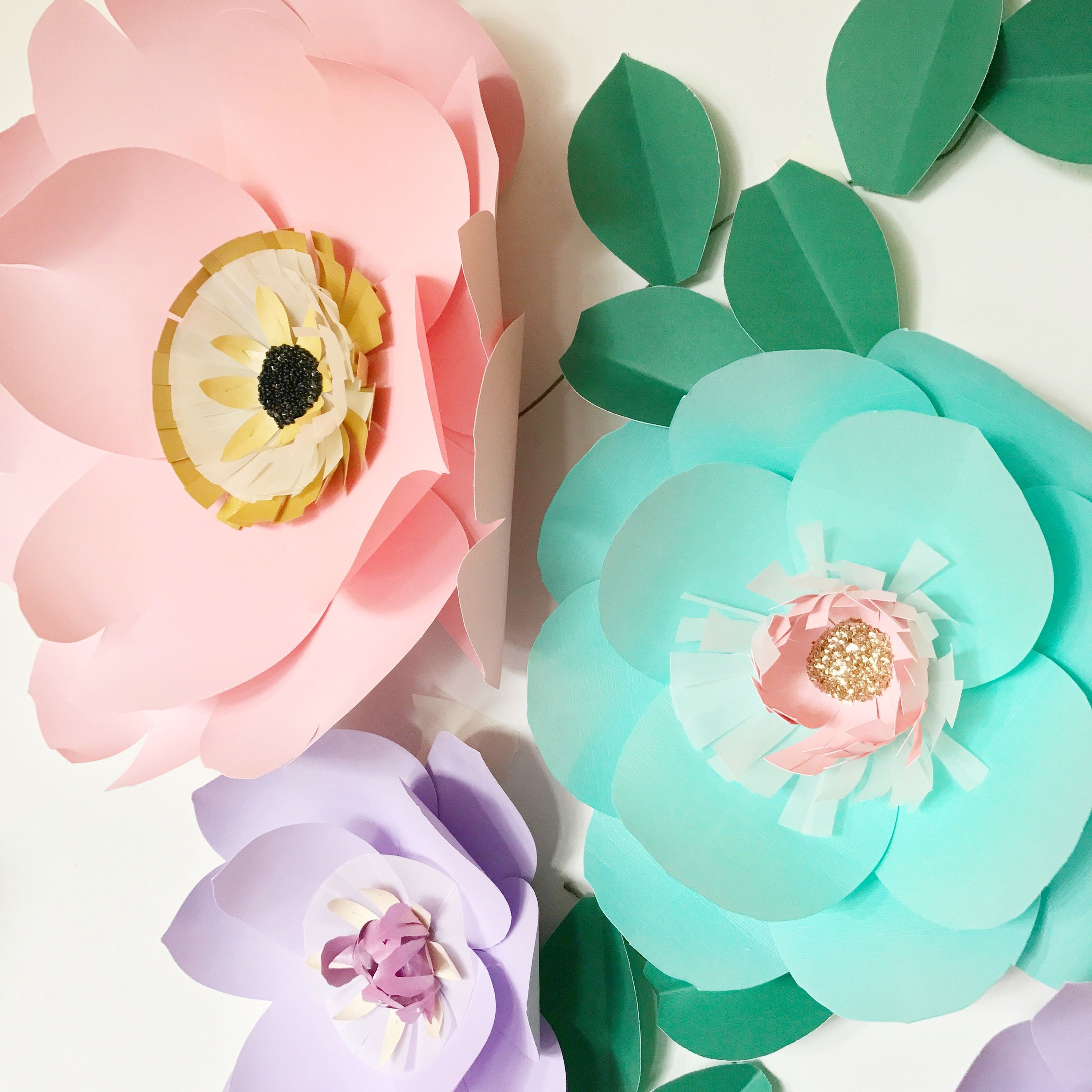 Large paper flowers wall decor for a baby girls nursery room or as