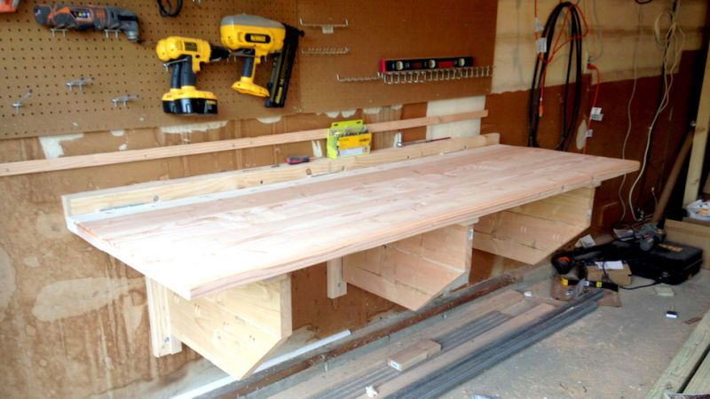 This Diy Floating Workbench Folds Into Place When It S Time To