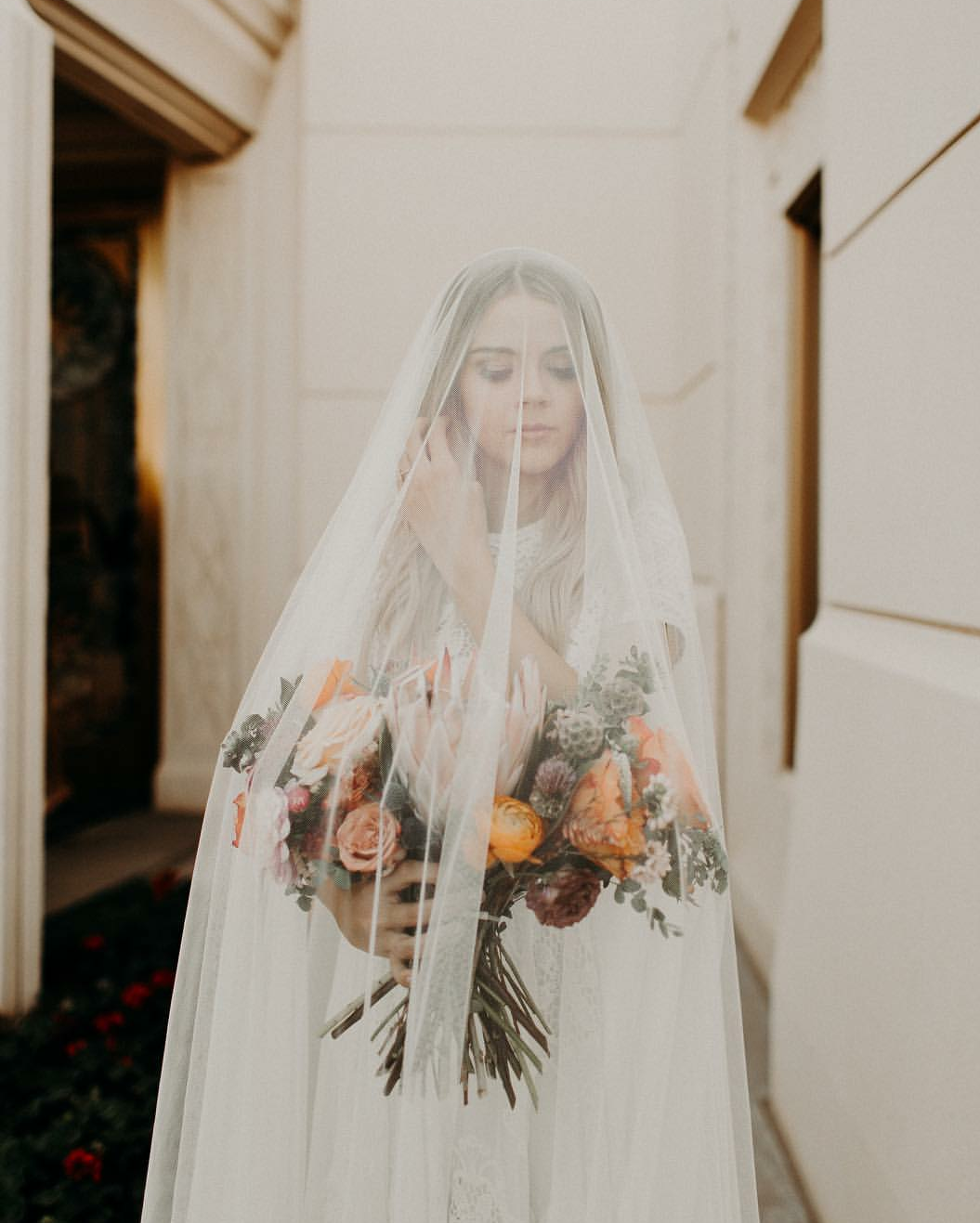 Modest wedding dress with cap sleeves from alta moda photo by