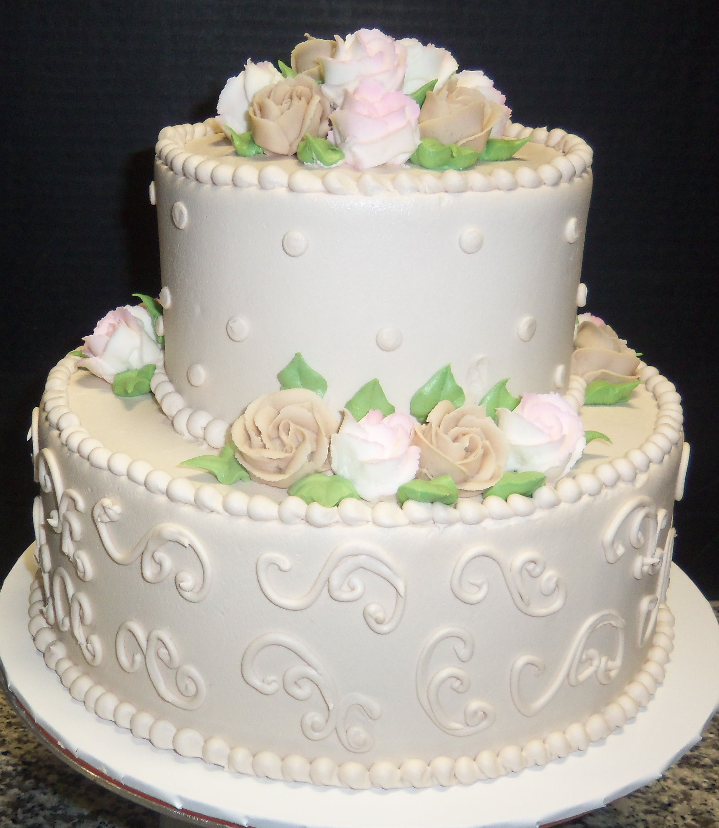 White Buttercream Iced 2 Tier Cake With Beige And White Roses