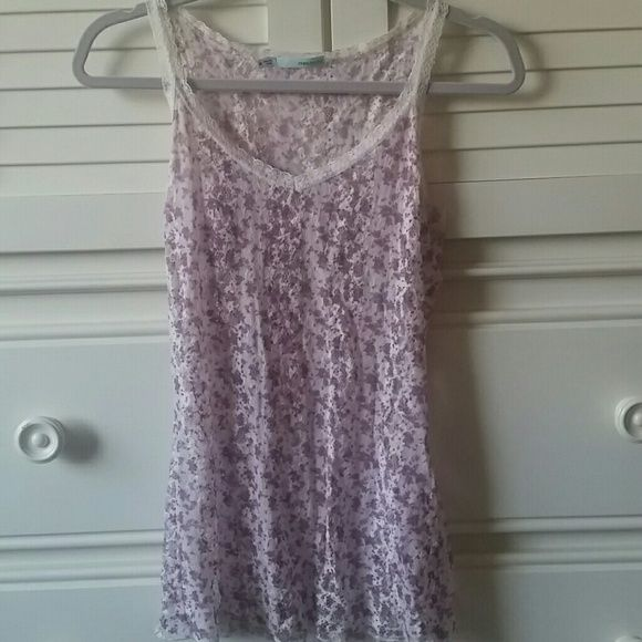 Maurice floral tank Very cute floral tank from Maurices. It's see through, so you need a tank underneath.  It's got a nice lacey pattern to it with all lace and thin straps.  Made of 85% nylon amd 15% spandex. Make an offer! Maurices Tops Tank Tops