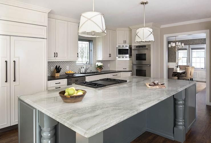 White and gray kitchen features white perimeter cabinets ...