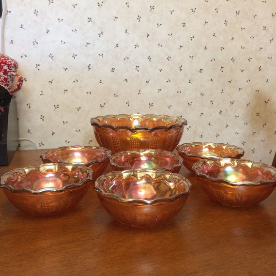 Vintage Antique Imperial/Fenton/Atlas( made by all three) Glass. Marigold Carnival Glass Diamond Point Columns, Master Serving, fruit, dessert bowl with 6 smaller berry serving bowls.  Set of 7 includes 6 Small Berry, Dessert or Cereal Bowsl, larger matching bowl. This is a vintage pattern, made from the 1909 to 1930. Rare to find the entire set. This pattern features an all over pattern of alternation rows of plain and checkered panels, bottom has a starburst design and the edges a...