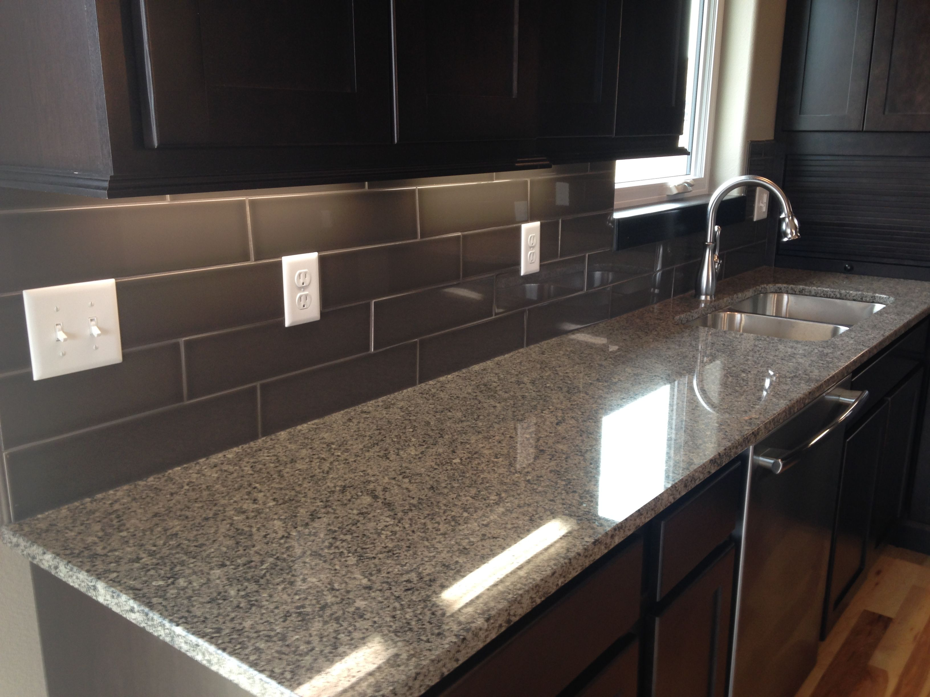 Kitchen backsplash in a 4x16 dark subway style tile | Design by ...