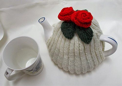 Hand knitted Cream tea cosy with red flowers fits a 4 - 6 cup tea pot >>> Check this awesome product by going to the link at the image.