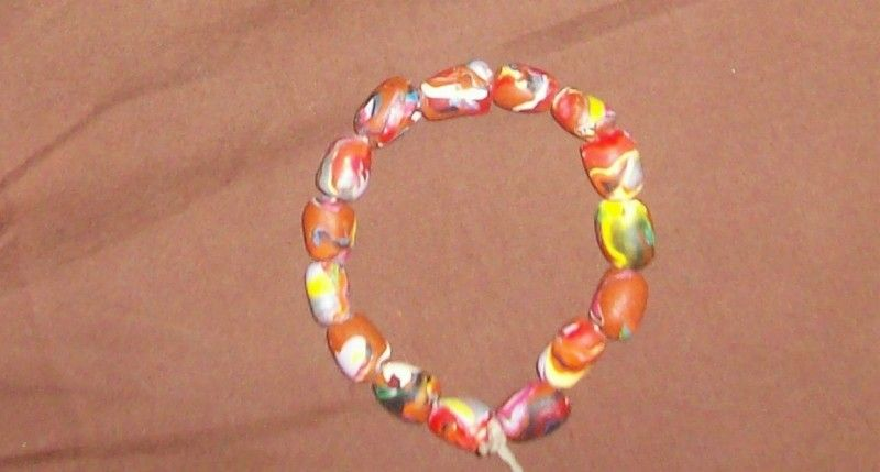 A bracelet made with different colored Sculpey twisted together...shaped into beads...hollowed with a toothpick...baked and strung.