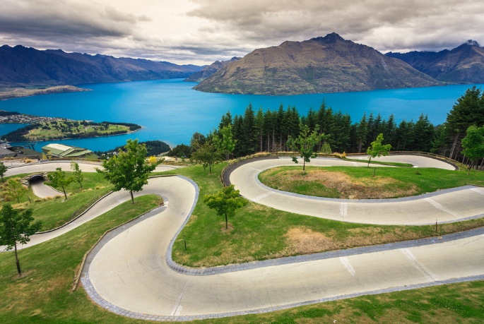 Luge track with the beautiful lake and mountain skyline in the background. Queenstown, New Zealand.