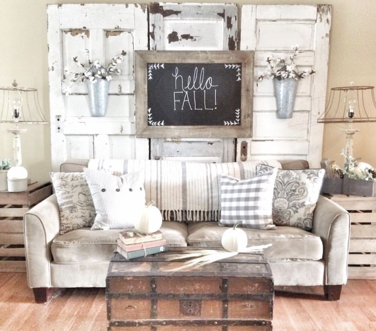 Farmhouse living room! Using vintage chippy doors behind couch. IG ...