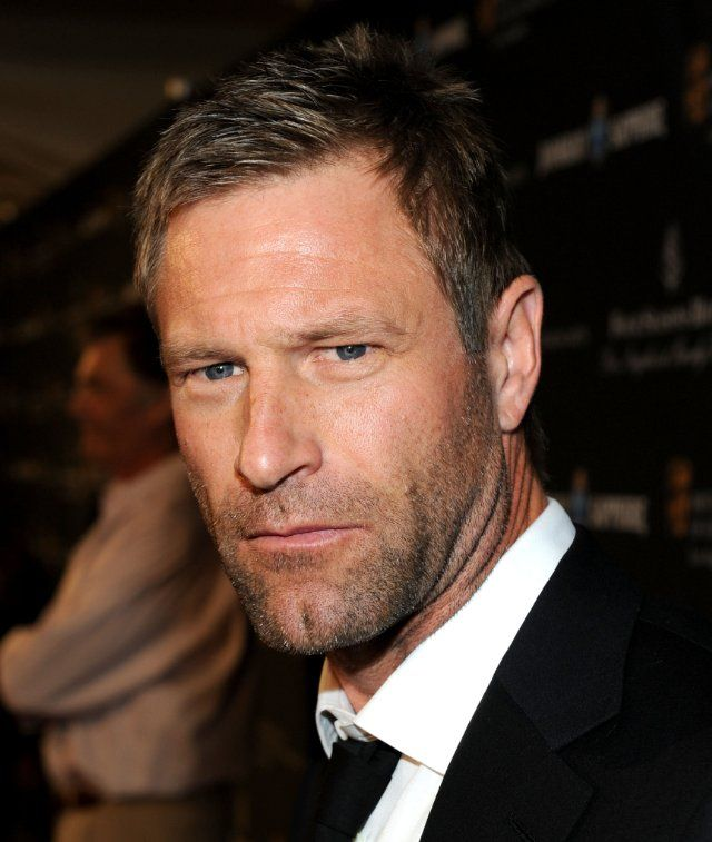 Aaron Eckhart... I like him, there is something in his eyes