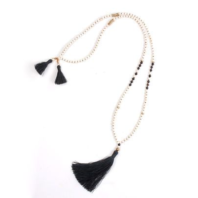 awareness necklace in white and black beads
