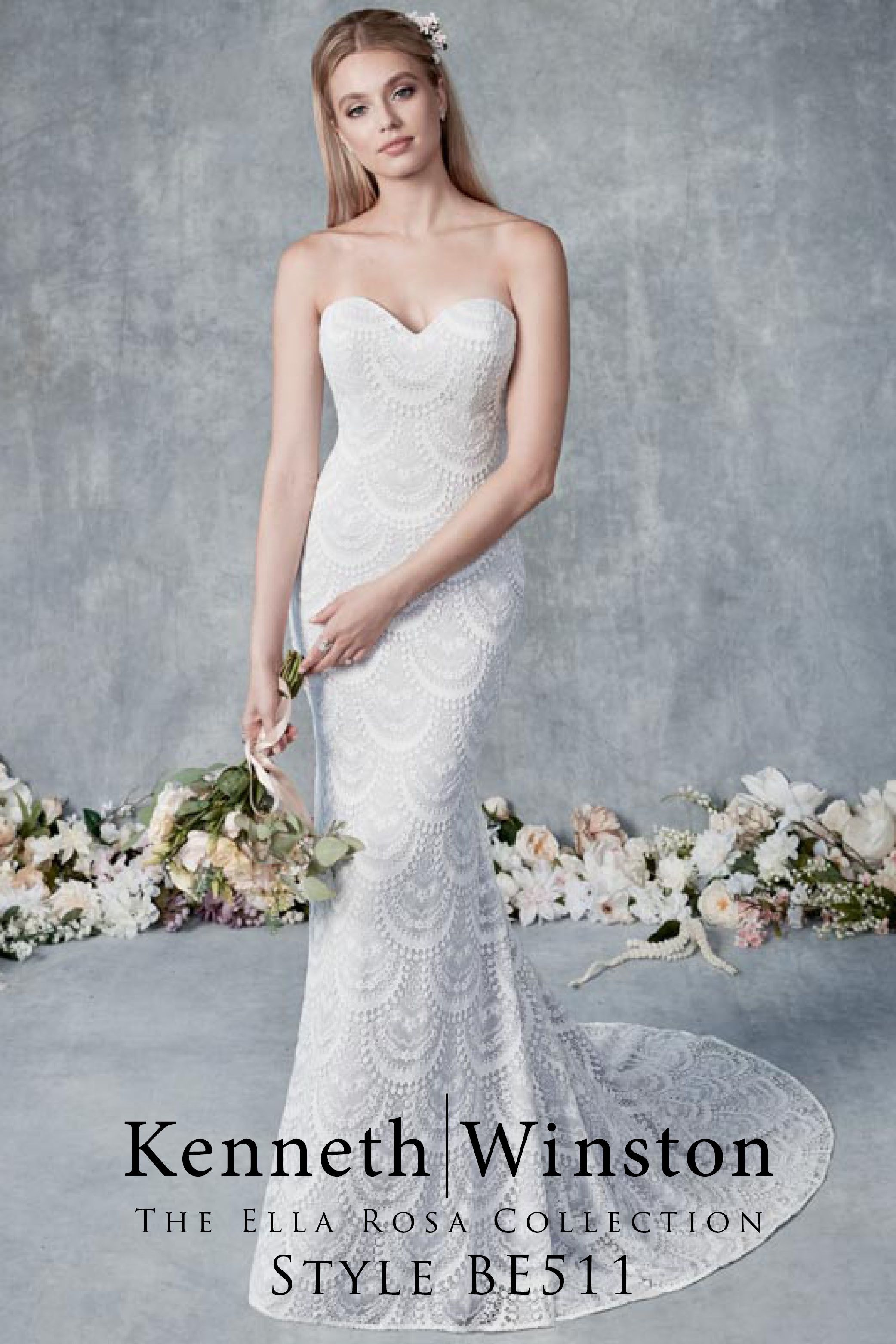 Intricately patterned vintage lace wedding dress shown in