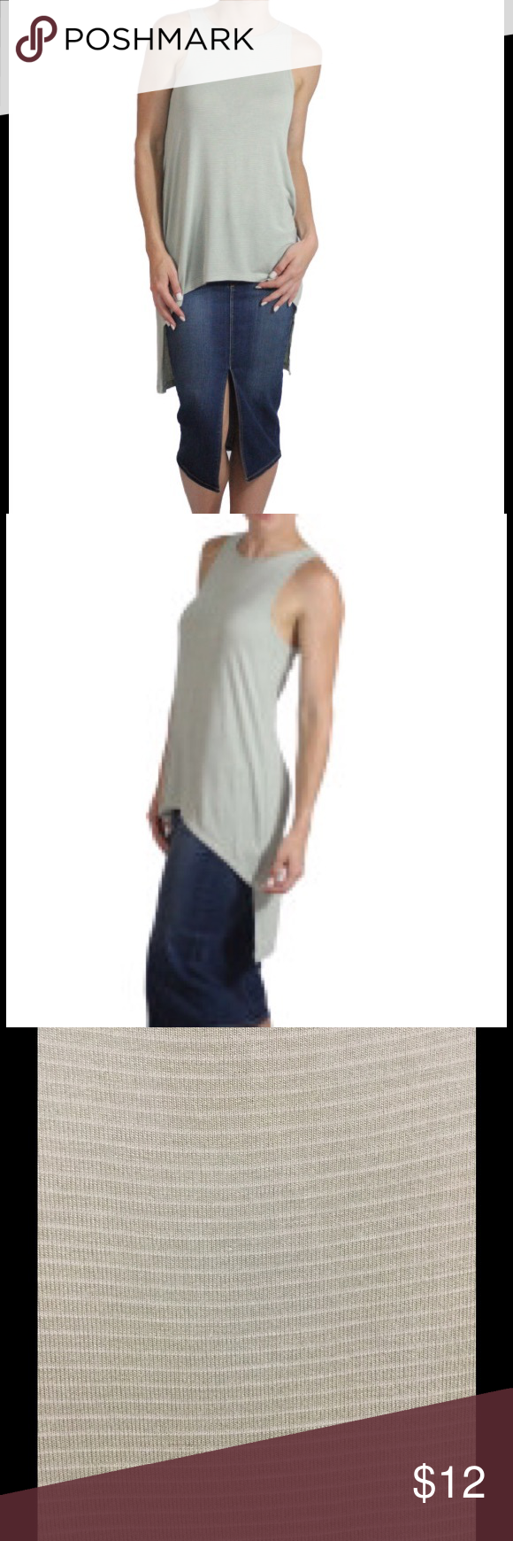 On the Road tank High low. Has tiny white strips. Never worn. All sales final. No trades. Price is firm. Marked at 75% off. On the Road Tops Tank Tops