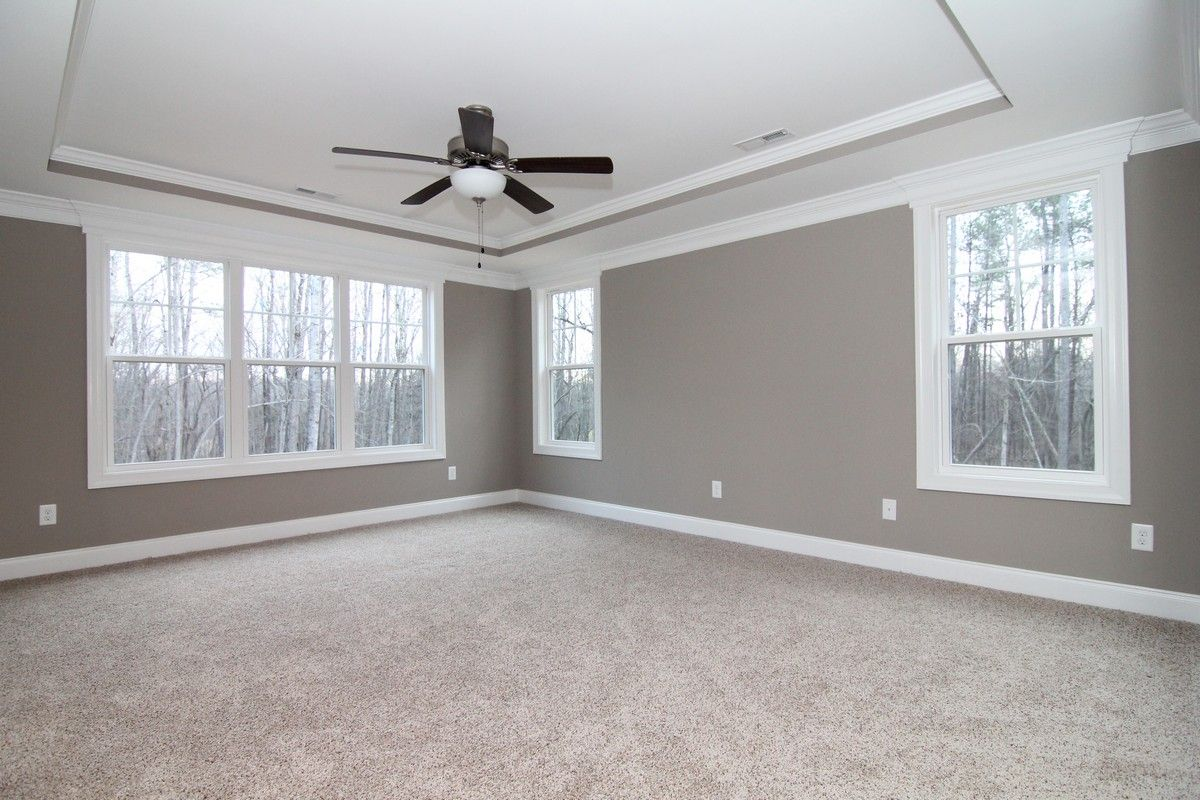 The Upstairs Master Bedroom Incorporates A Subtle Trey Ceiling