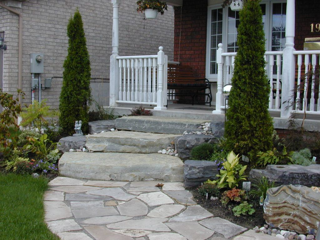 Big slab and natural placement of slate on walkway front for Front garden stone ideas