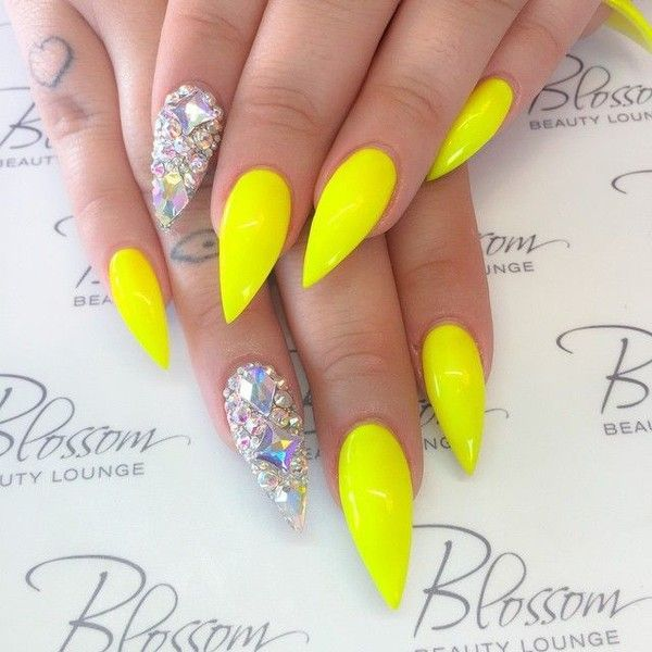 Neon yellow stiletto nails with bling fing ❤ liked on Polyvore ...