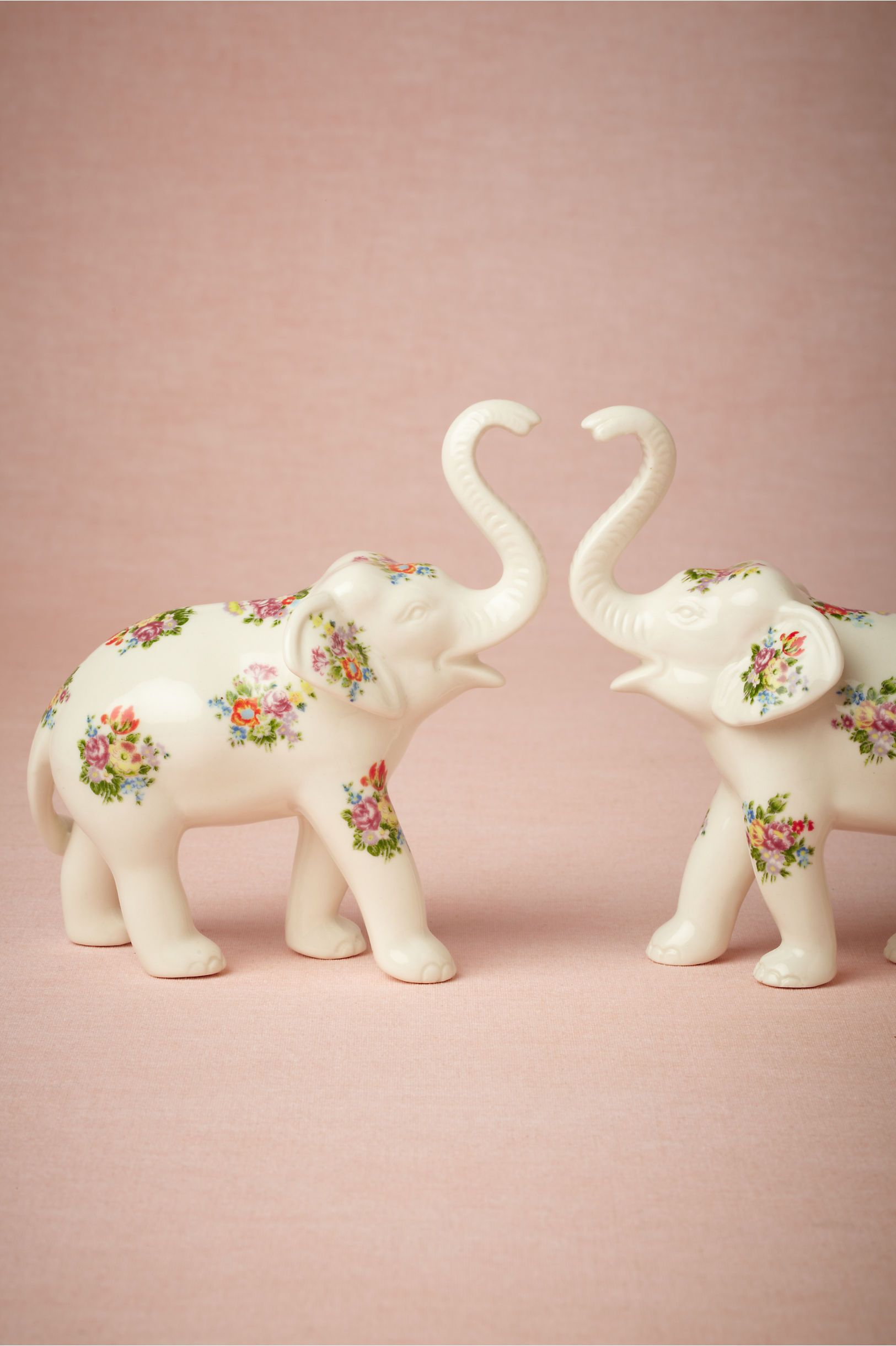 i know these flowery elephants are cake toppers, but I just love ...