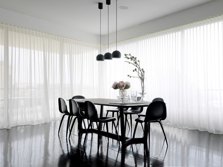 Contemporary Dining Room Looks Stunning With S Fold Sheer Curtains Dining Room Contemporary Monochrome Dining Room Black Dining Room