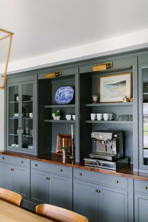 Chic Dining Space Features A Wall Of Dark Gray Built In Shelves Lined With An Espresso Machine F Living Room Built Ins Dining Room Cabinet Living Room Cabinets