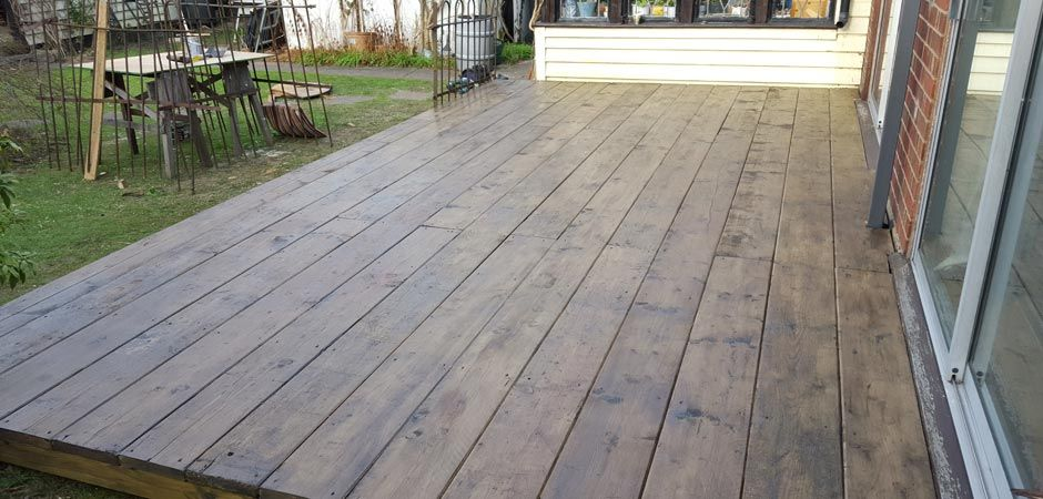 reclaimed scaffold board decking hockley essex courtyard