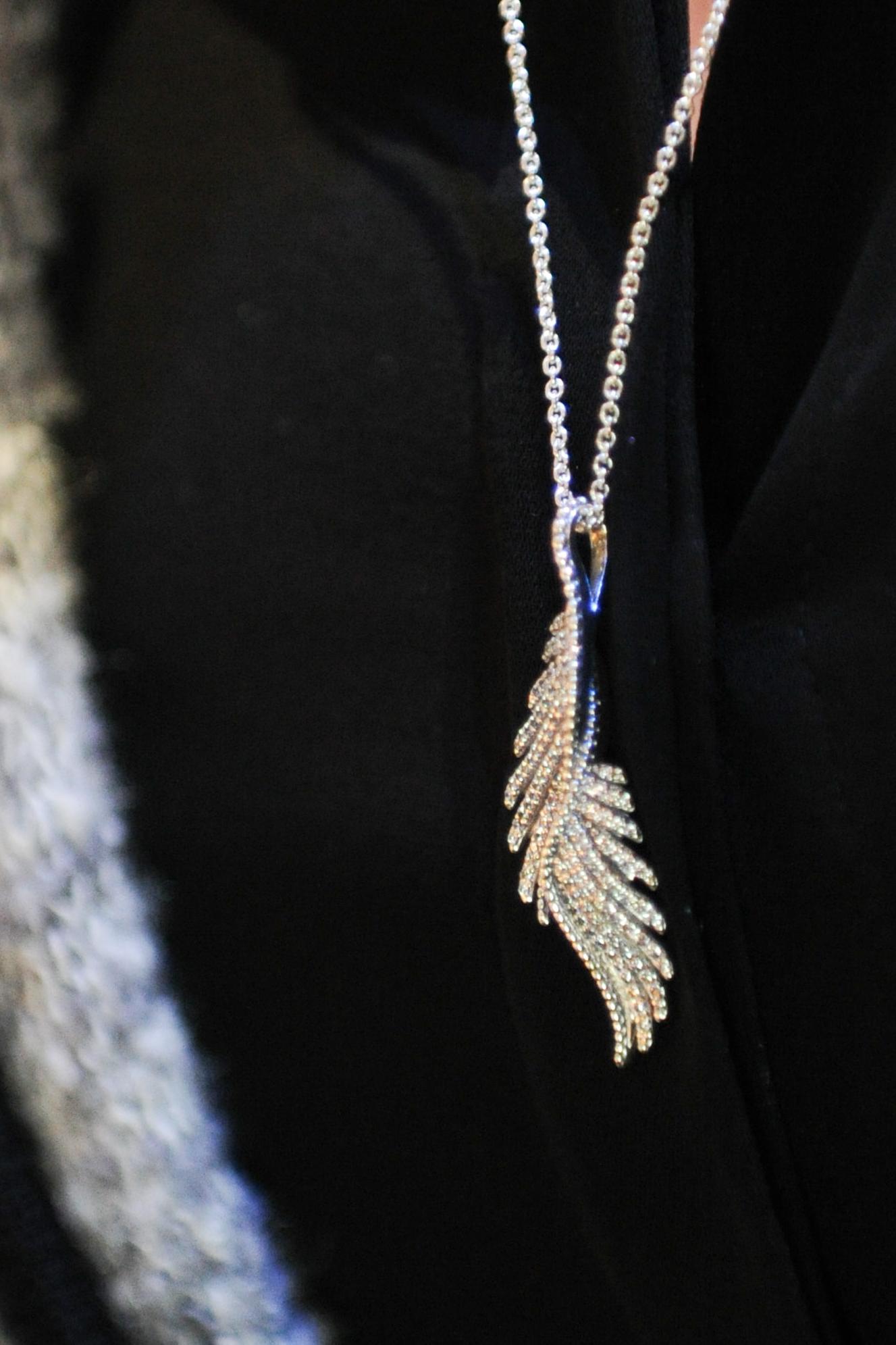 acff9a8ba Janette Ewen with the stunning PANDORA phoenix feather necklace.  #PANDORAatWMCFW #PANDORAsponsors