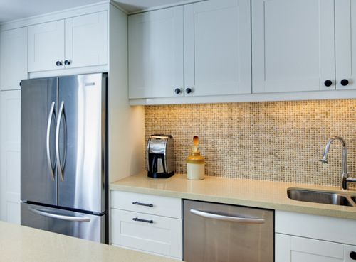 Small kitchen tall cabinets surround fridge tiny tile for Kitchen ideas singapore