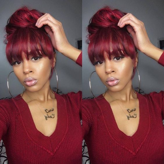 Red Bombshell Messy Bun With China Bangs Achieve This Look With