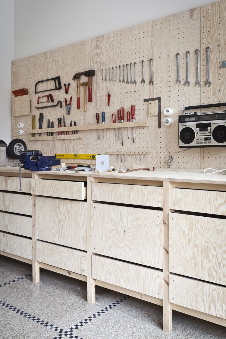 Bench is off floor. Pegboard is a good idea. I like the