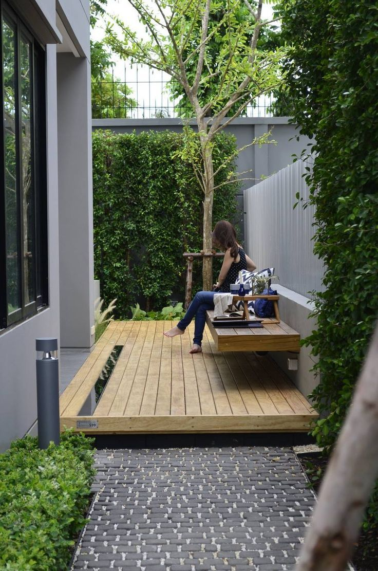 Varying textures, grey tones and timber create a lovely outdoor area. #sideporch