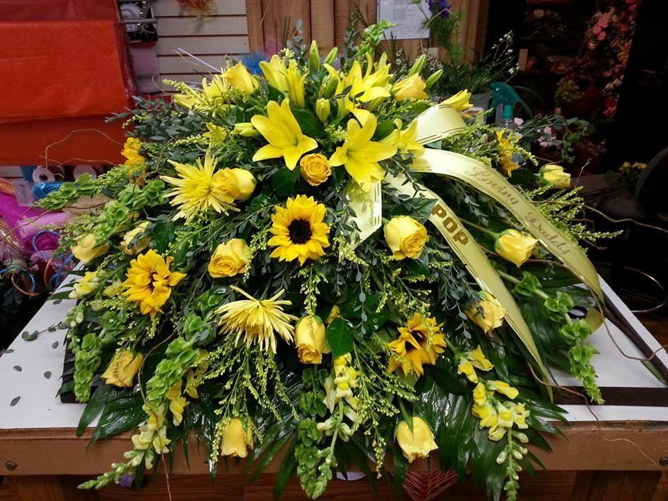 An amazing casket spray from Carthage Flower Shop in