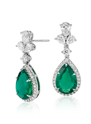These Earrings Showcase Vibrant Pear Shape Emeralds Accented By A Beautiful Three Stone Diamond Cer Drop Detail Set In 18k White Gold