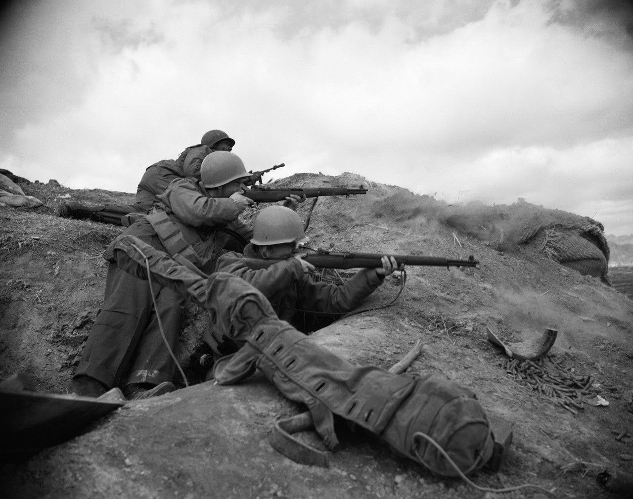 Soldiers from the USS Eldorado shoot at enemy targets from an infantry outpost, Korea, 1951