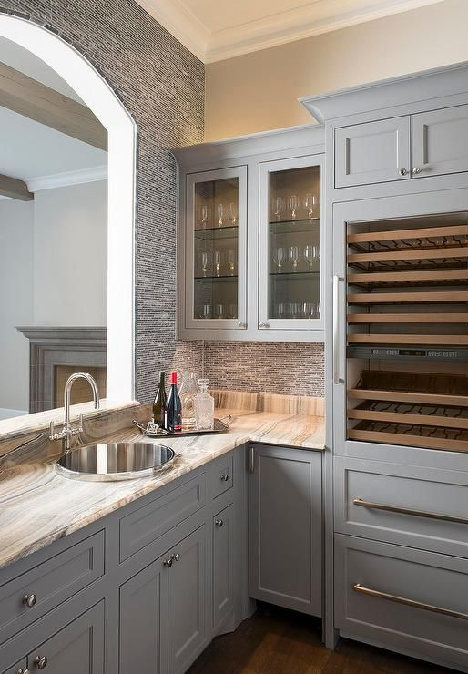 An arched pass through window opens to a butlers' pantry