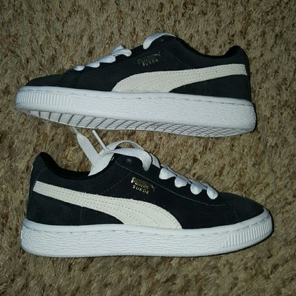 Kids puma shoes Black and white puma shoes size 12 never been worn, only tried on. Puma Shoes Sneakers