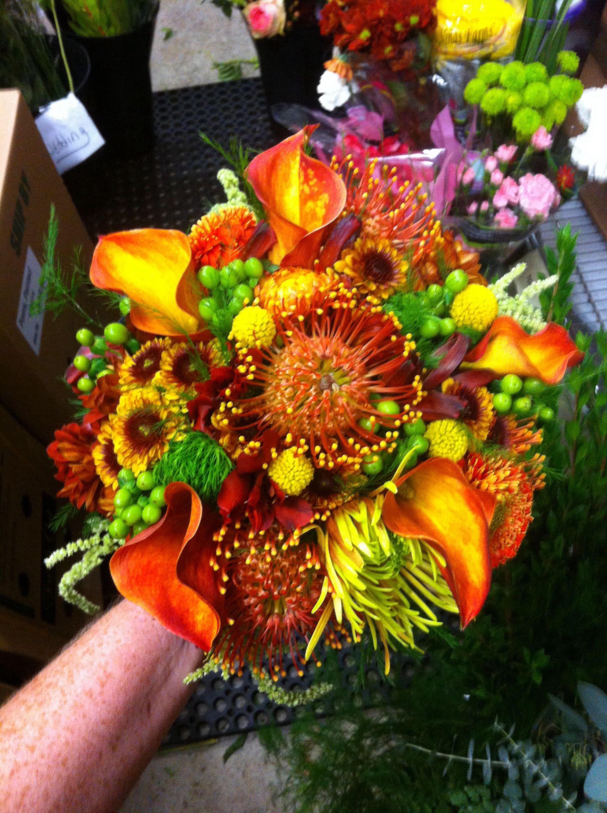 Orange calla and protea bouquet