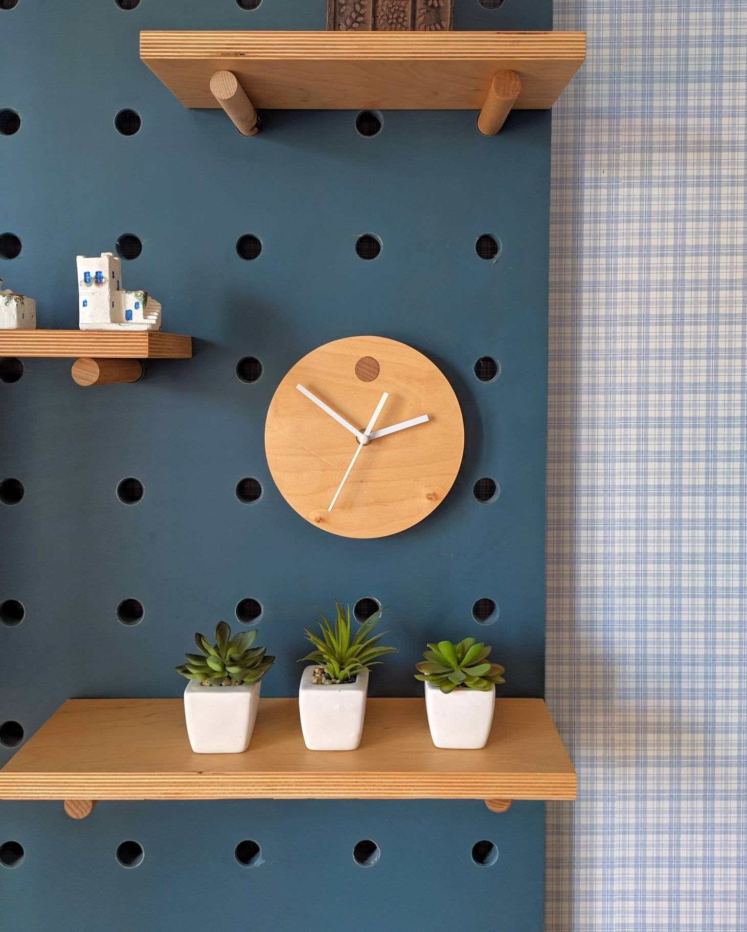 Photo of Plywood clock for pegboard organizer. Accessories for pegboards
