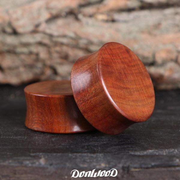 Wooden double flare ear plug made of Plum wood.