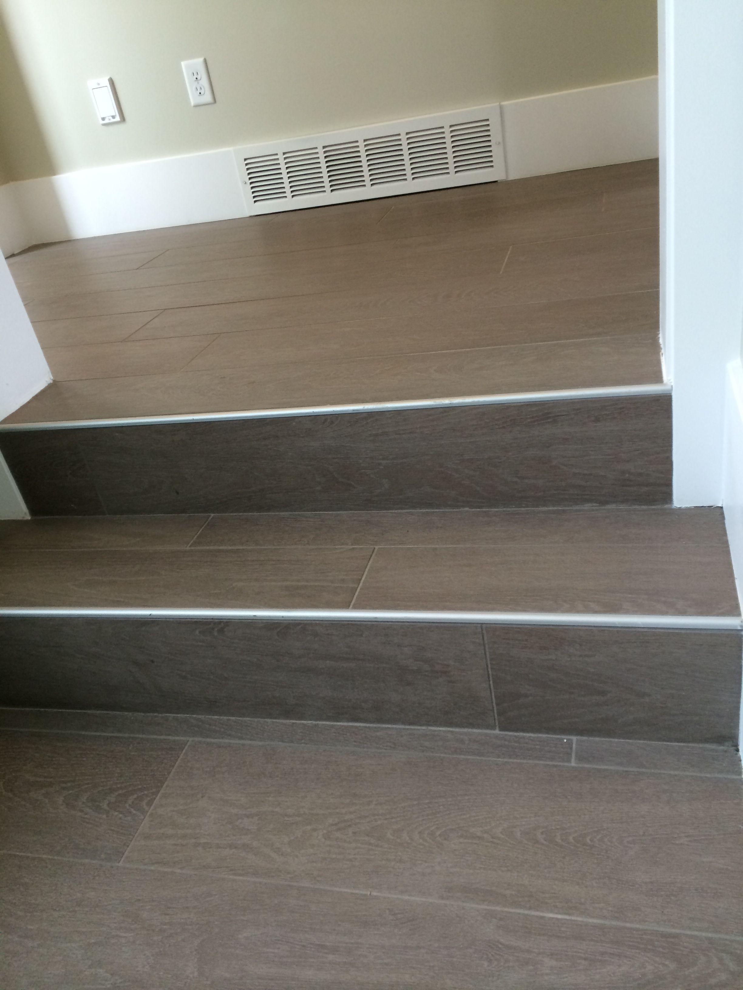 Wood floor tile on stairs with metal end cap