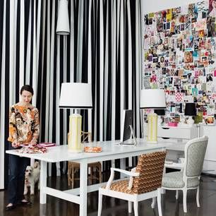 Dramatic home office.  Love the black & white stripe curtains and the massive moodboard..