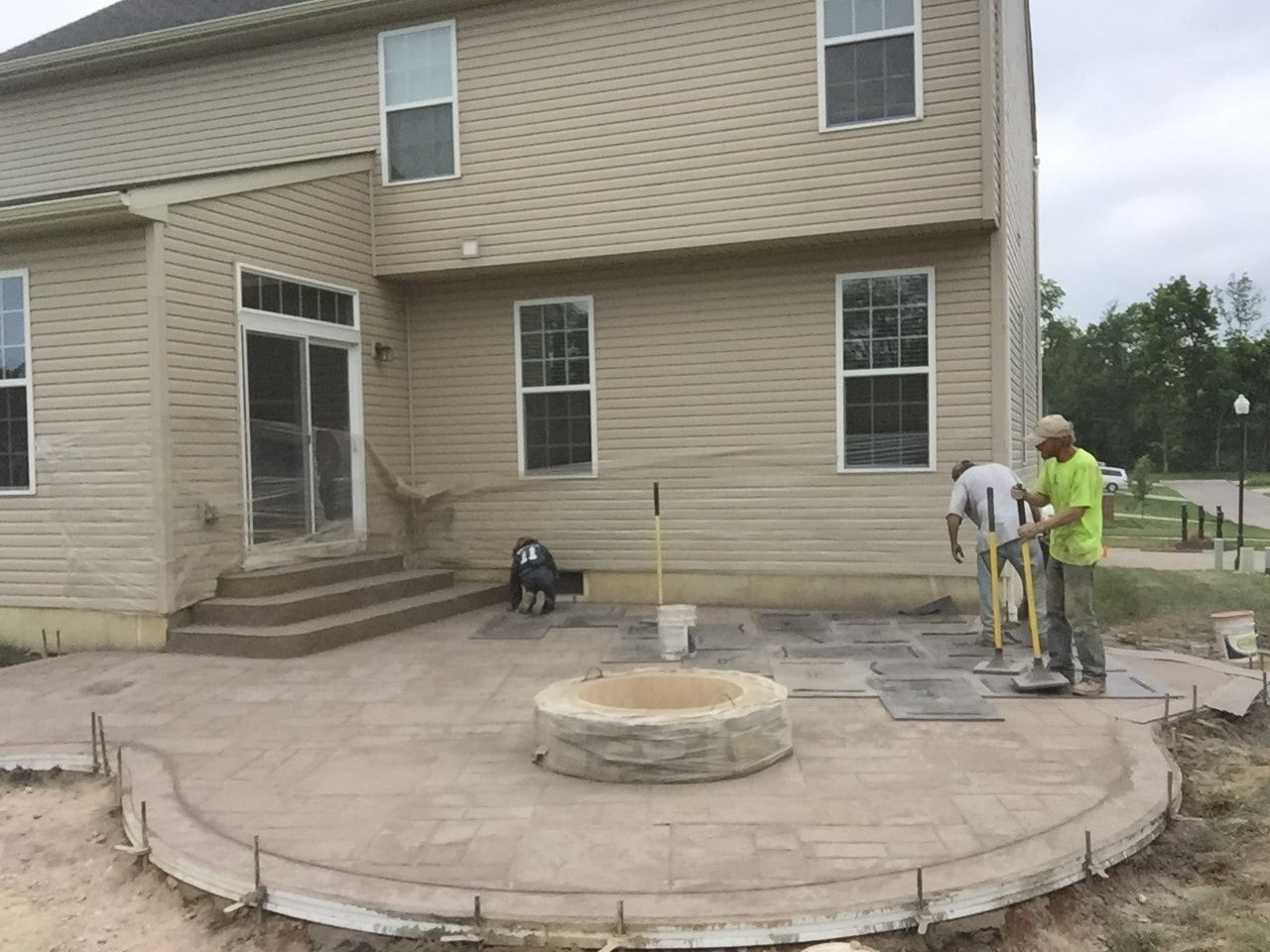 Pouring Decorative Concrete Patio with Fire Pit and