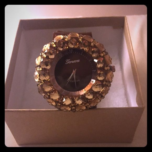 Topaz rhinestone watch Watch has a black face plate surrounded with topaz rhinestones and dark brown watch strap. Brand new and in perfect condition with no scratches or any missing rhinestones. Neutral and perfect statement piece -sensible yet stylish -rhinestones give it a stand out shine Jewelry