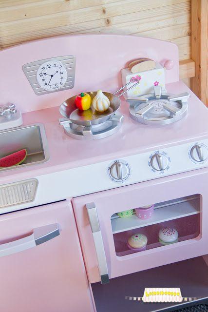 Kid Kraft kitchen in a play house.