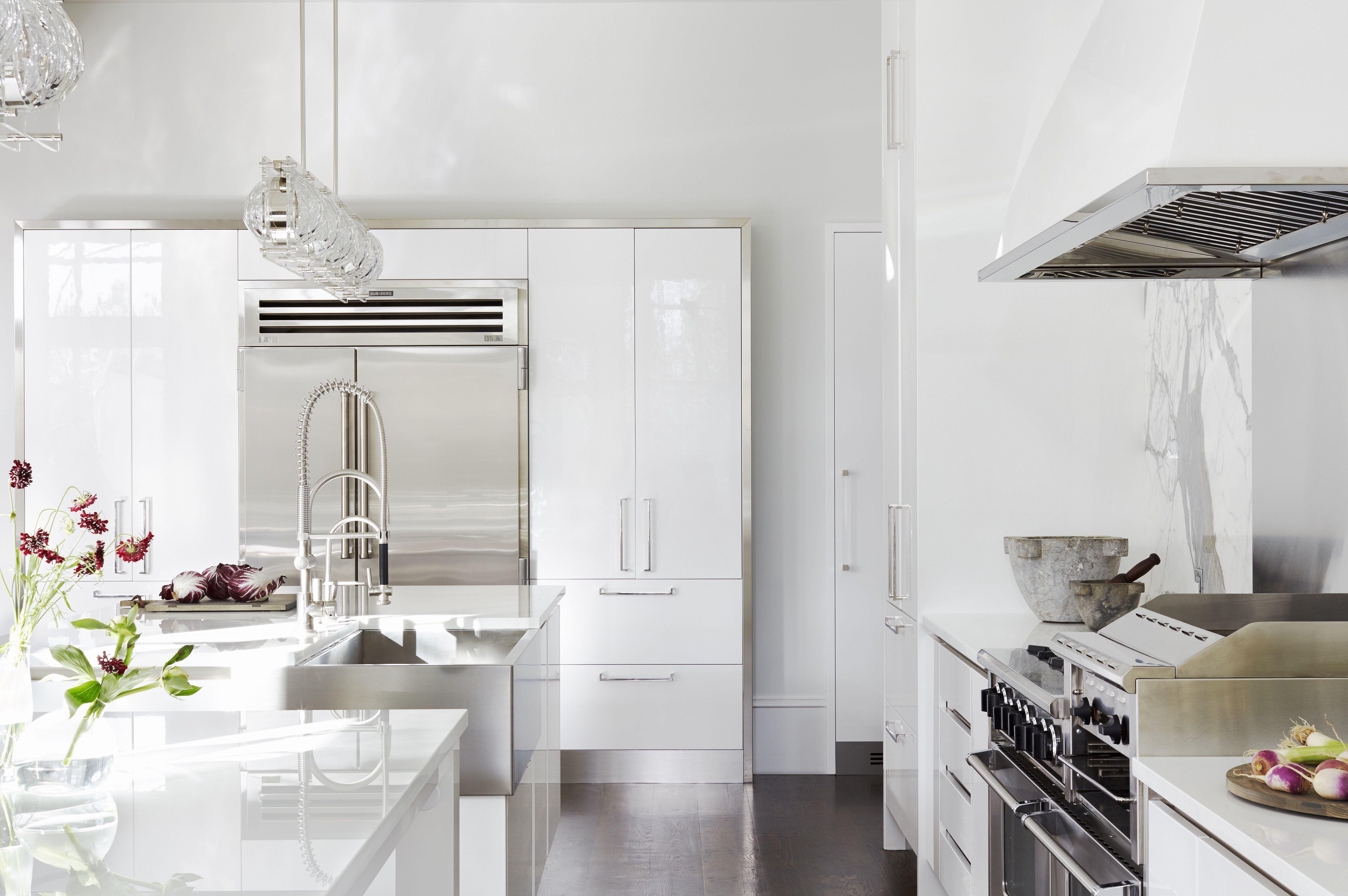 Contemporary Kitchen With Glossy White Cabinets And Steel Apron Sink White Glossy Kitchen White Modern Kitchen Interior Design Kitchen