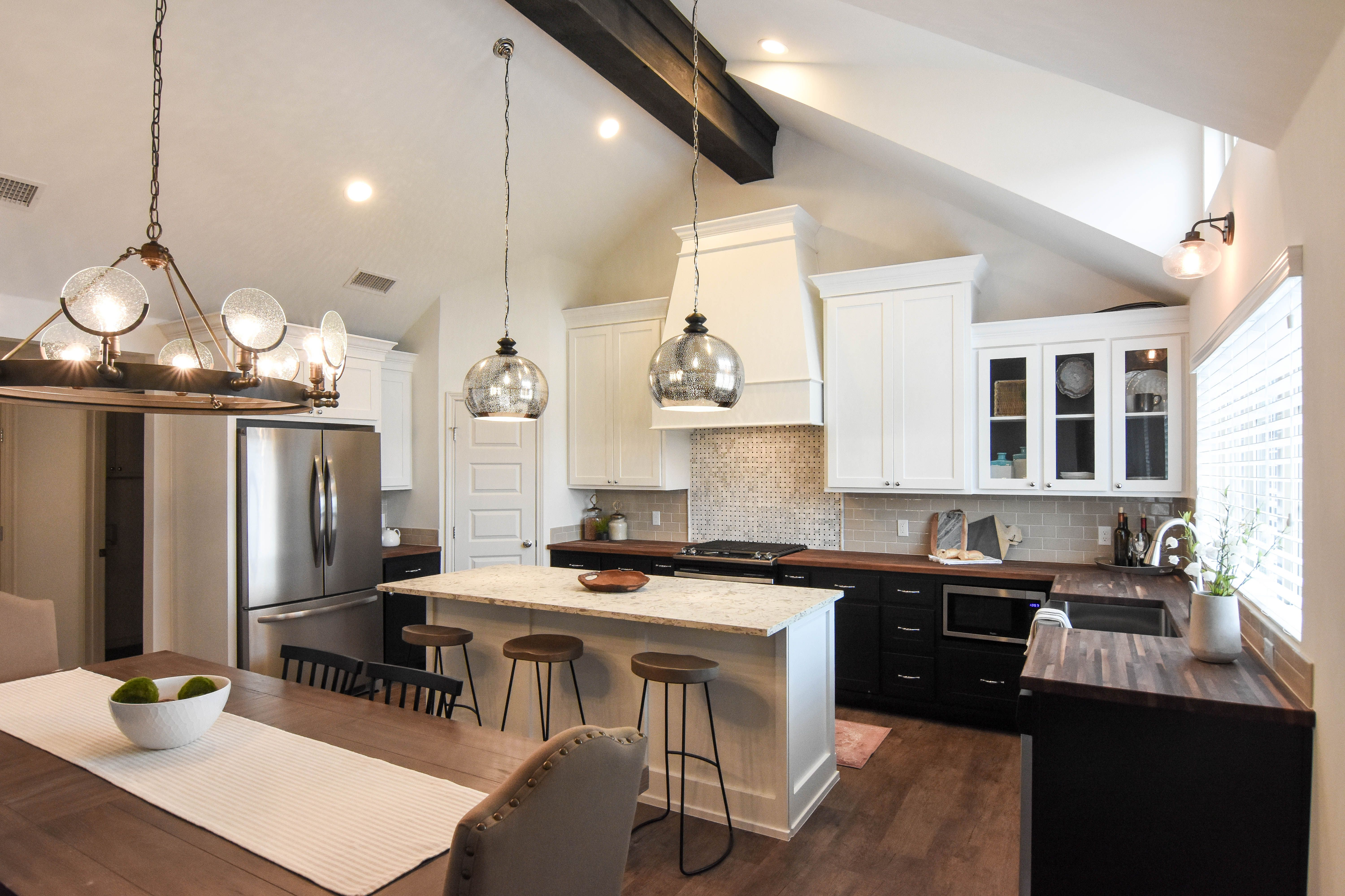 Ventura Homes Lubbock Tx This Bold Kitchen Design Features Two Toned Black And White Cabinets And A Butchers B Bold Kitchen Ventura Homes Wood Countertops
