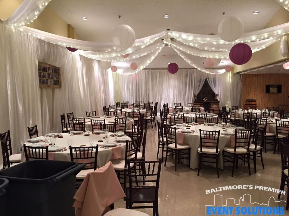 Pipe And Drape Lighted Ceiling Drape And Paper Lanterns For