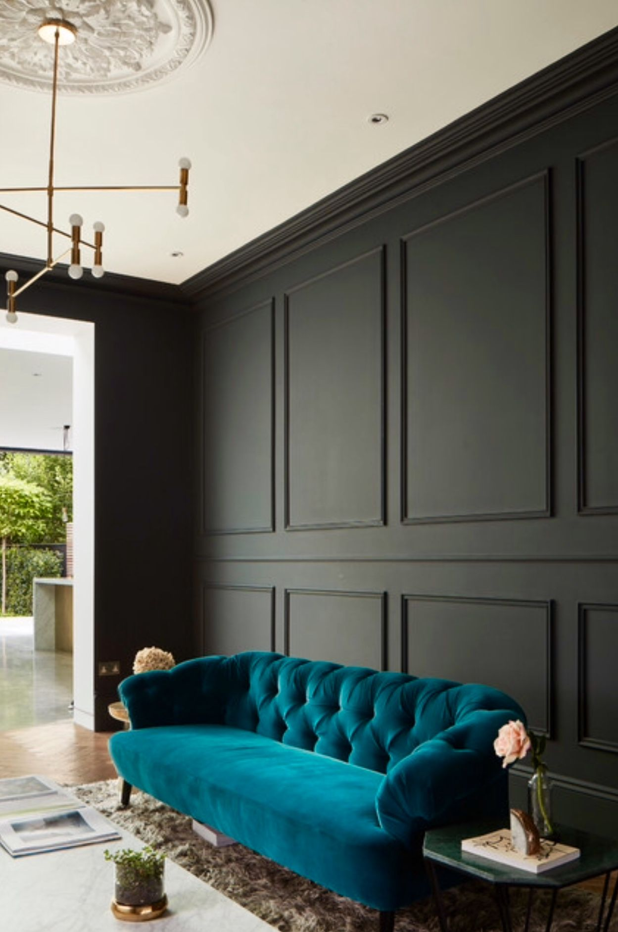 The Dark Value Of The Black Wall Highlights He Vivid Chroma Of The