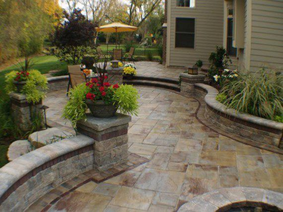 patio and curved walls by unilock with