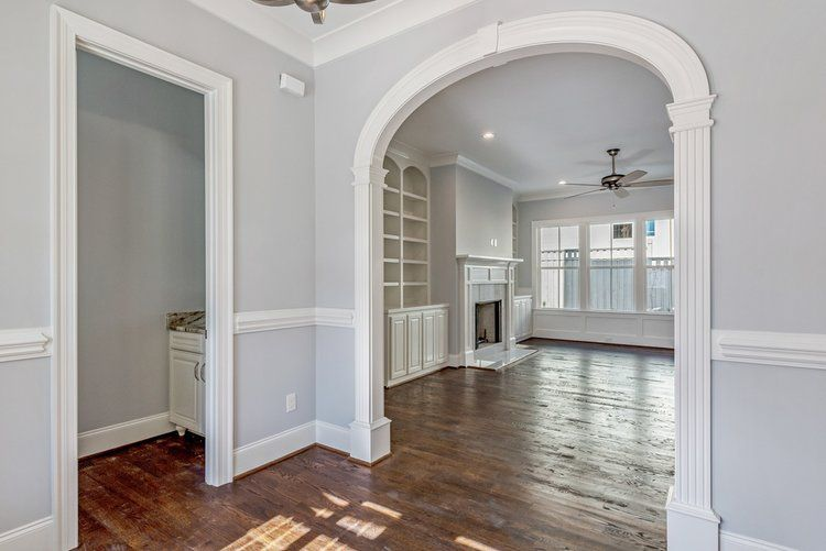 Traditional Arched Opening Detail In Foyer Setting 5 Wide Casing Profile Fluted Columns Elliptical Shape Arched Doors Family Room Layout Arch Interior