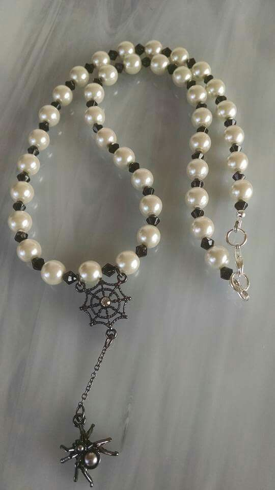 Glass pearls, jet crystals and a gunmetal colored spider web with spider necklace